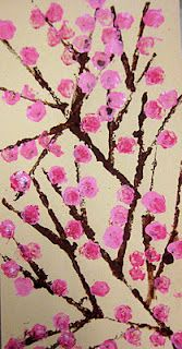 This is a two day project for 1st. We first used found objects to stamp our cherry blossom trees. We used cardboard to create straight lines and rolled up scraps of bulletin board boarder to create the blossoms.  On day two students will use oil pastels to create more variety and texture in their flowers. Two strips of red construction paper will be pasted on the top and bottom of their artwork, and a small piece of string will be attached to the top to complete the scroll.