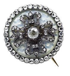 A silver-gilt, enamel and diamond brooch.Fabergé,  St. Petersburg (partial mark), Mikhail Perkhin, inventory number 2425, import markcircular, with quatrefoil design in rose-cut diamonds, centred with larger circular-cut diamond, enamelled in translucent oyster white over wavy engine-turned ground within diamond border