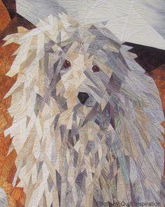 "Close- up, ""Snow Buddies"" art quilt by Ruth Powers. This dog is a Komondor, a rare breed.  Exhibited at the  2013 Houston IQF.  Photo by Quilt Inspiration: It's Raining Cats and Dogs - Part 2"