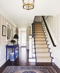 entryway, stairs, seagrass runner, oriental rug, wallpaper