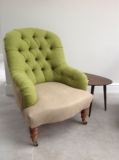 Deep buttoned iron back, traditionally upholstered in Moon wool fabric and Belgium military hessian