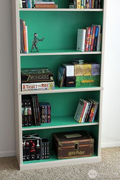 Painting laminate furniture can be intimidating, but it's easier than you think. Check out this bookcase makeover!