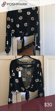 Floral open back t-shirt! Brand new. Tags attached. Long sleeve. Tops Crop Tops