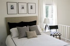 classic black and white bedroom. the chair's pattern keeps the room interesting