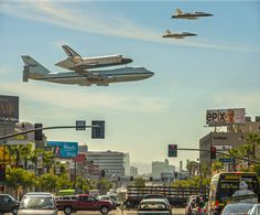 Space Shuttle Endeavour flying over LA on the NASA 747 carrier with a fighter escort.