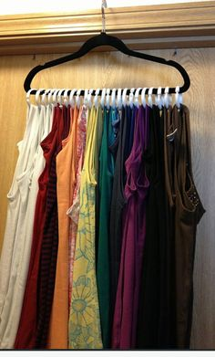 What a great way to hang singlets. A coat hanger and some curtain rings. This could also be used for scarves, belts, etc.
