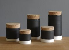 set of 5 porcelain containers. black / white. ceramic corked jar. handmade modern pottery. white porcelain. minimalist ceramics.