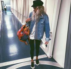 Baggy denim jacket, t-shirt, leggings, slip-ons or sneakers, and a cap.