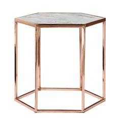 A copper-plated hexagonal coffee table with a marble top. Copper Plated Coffee Table With Marble Top Rose Gold Bed, Rose Gold Rooms, Hexagon Coffee Table, Marble Top Coffee Table, Coffee Tables, Marble Bedroom, Gold Bedroom, Copper And Marble, Rose Gold Marble