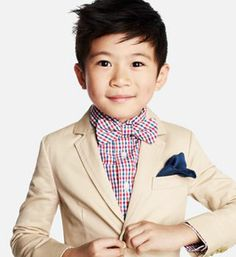 The fashionable kid: Ring bearer red white and blue checkered shirt + bow tie, tan suits and navy pocket square.