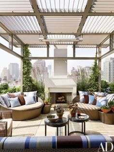 modern rooftop terrace features a custom trellis and an outdoor fireplace.A modern rooftop terrace features a custom trellis and an outdoor fireplace. Outdoor Seating, Outdoor Rooms, Outdoor Living, Outdoor Decor, Indoor Outdoor, Outdoor Bedroom, Architectural Digest, Rooftop Terrace Design, Rooftop Patio