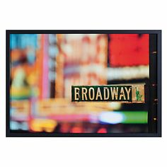 This beautiful photograph, titled On Broadway, is a blurry view of Times Square with the Broadway street sign being the only thing in focus.   #ZGallerie  #Art  #Photography