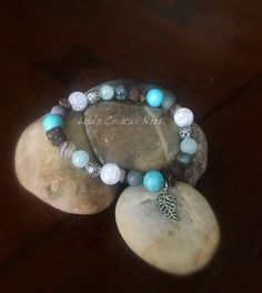 Essential oil diffusing teal stretch bracelet with charm by LisaCreativeNook on Etsy https://www.etsy.com/listing/264078954/essential-oil-diffusing-teal-stretch