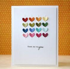 Süße Grußkarte mit Herzen. Einfach die Herze mit Nadel, Faden und einem einfachen Stich an die Karte nähen.