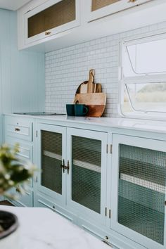 Old glass cupboard fronts were removed in the renovated kitchen and given a style update with brass wire netting. White subway tiles form the splashback in The Block's Michael and Carlene's renovated vintage retro camper van caravan. Vintage Caravan Interiors, Retro Caravan, Retro Campers, Vintage Caravans, Vintage Travel Trailers, Vintage Campers, Caravan Ideas, Camper Ideas, Vintage Airstream