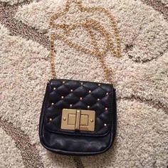 🎉HOST PICK🎉Aldo black cross body bag Brand new Aldo cross body bag has gold studds as shown with gold chain.                           🎉host pick- best in bags party- 8/10/16🎉 ALDO Bags Crossbody Bags