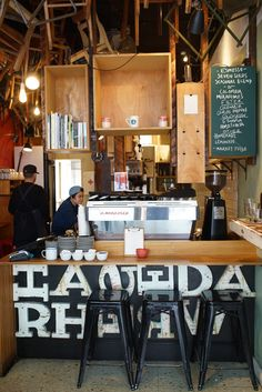 Brother Baba Budan, Café with chairs at the ceiling in Melbourne - belongs to the roastery small betch