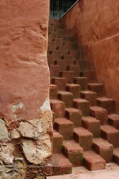 Stepped blocks to form unusual staircase. <:((((><(