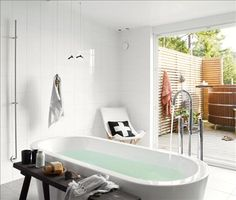 Bath tub and large windows
