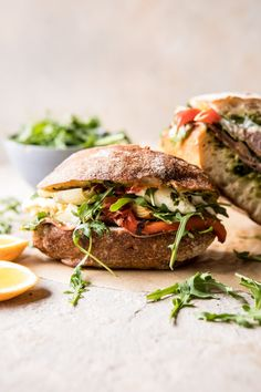 Antipasto Mozzarella Sandwich with Lemony Basil Pesto: This sandwich makes for the perfect fancied up weekday lunch. It would also be great to pack up and take on a spring picnic. Oh, and if you happen to be serving Easter lunch, this sandwich would be perfect for that too! @halfbakedharvest.com