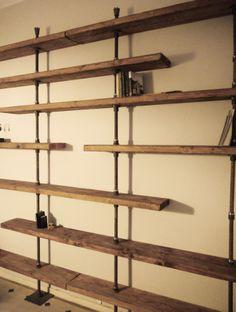 Librería a medida en hierro y madera reciclada