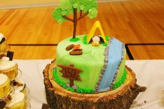 """Scout cake, love that it's displayed on a """"tree stand"""""""