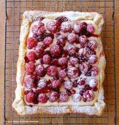 Rustic Raspberry Lemon Cheesecake Tart: puff pastry, cream cheese, sugar, heavy cream, lemon curd, raspberries, raspberry jam, powdered sugar