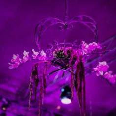 A lovely flower chandelier by KM Events #flowerdecorations #purple #weddingdecorations #weddings