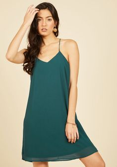 When your social calendar demands that your style game be as strong as your scheduling savvy, this sea green dress is up for the challenge! Supported by sleek spaghetti straps and detailed with a breezy cutout on its racerback, this shift dress just needs a simple accessory update or shoe swap before hitting your next event.