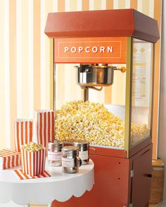 We'd never knock an amazing display of cheese and crudités, but we can't think of a better way to kick-start cocktail hour (or refuel the dance party) than with a retro-inspired popcorn cart, plus taste bud-tickling topping recipes.