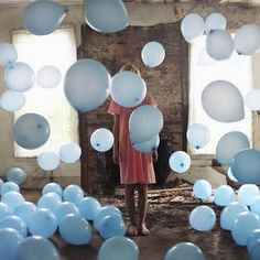I love that the balloons and dress are the only non-neutral colors, and that the balloons are fun, yet the girl is just standing there. Art photography by Alex Stoddard Bubble Balloons, Blue Balloons, Floating Balloons, Heart Balloons, Labo Photo, Partys, The Balloon, Balloon Party, Balloon Ideas