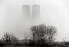 The twin towers of the World Trade Center seen through fog from Liberty State Park in Jersey City, N.J., on Dec. 31, 1994. Photo by Keith Meyers/The New York Times