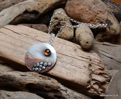 Silver and copper pebble beach pendant with amber sun