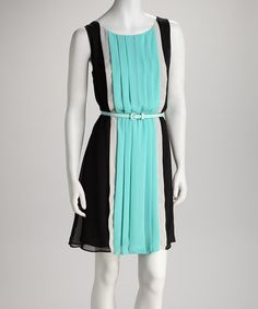 For an enchanting ensemble that's right on trend, opt for a dress that's classically feminine yet comfortable. Perfectly placed pleats and a belted waist pull this color block piece together.Measurements (size M): 39'' long from high point of shoulder to hem100% polyesterMachine wash; hang dry