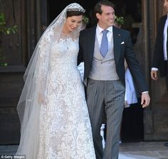 Loving: Prince Felix in his morning suit holds his new bride closely after the formal wedding ceremony is over and they went out to greet th...