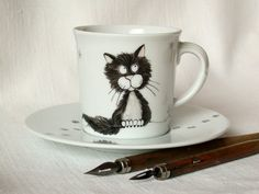 Hey, I found this really awesome Etsy listing at http://www.etsy.com/listing/108570212/black-cat-cup-and-saucer-handpainted-on