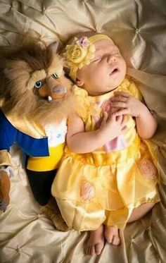 Beauty and the beast belle newborn baby photo. Could do this with all the princesses.