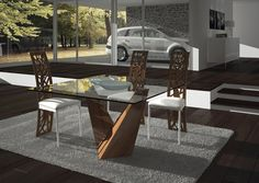 Here a fascinating glass table top with a walnut stand and detailing for the chairs. The browns and whites look great together. ➤ Discover the season's newest designs and inspirations. Visit us at www.moderndiningtables.net #diningtables #homedecorideas #diningroomideas @ModDiningTables