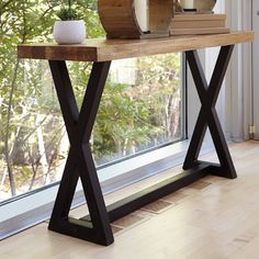 "Features:  -Can be used under a covered porch.  Top Finish: -Light brown.  Base Finish: -Black.  Top Material: -Solid Wood.  Base Material: -Metal. Dimensions:  -Distance between legs: 41"".  Overall H"