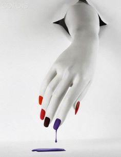 Mannequin's hand with dripping nail polish