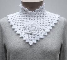 Flower Square Collar - PA-124e - A crochet pattern from Nancy Brown-Designer. This beautiful accessory requires some advanced crochet experience. Start with a flower granny square for the center front and add the sides. Fasten with a crocheted button and you have a soft, warm and elegant winter accessory. This pattern PDF can be purchased for $2.49.