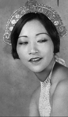 Anna May Wong,  a Cantonese of pure ancestry, whose exquisite voice and excellent Piano playing augment her acting talent. 1931 by Movie -Fan