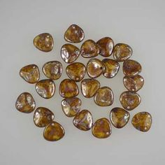 Czech glass rose petals in Brown Picasso, 8mm x 7mm.  Petal-shaped drop beads in a honey colour, with a shimmery brown and grey stone-like finish. UK seller.