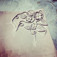Hand building.  Applied flowers to square plate. Mud Queen Pottery