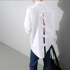 Most modern update to the boring white office shirt, show some back with this bow detail womens white collard shirt. Has a turned down collar. Looks best with those favorite leggings, tailored pants or jeans. One size fits most, very loose fit for those c Zerschnittene Shirts, Cut Up Shirts, The Office Shirts, Tie Dye Shirts, Party Shirts, Shirt Blouses, One Direction Shirts, White Shirts Women, White Women