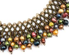 SALE! - regularly $198.95! Boldly vibrant faceted crystals in paraiba blue, lemon yellow, intense orange, and radiant red are woven into stunning links of fringe that is tipped with mahogany obsidian and black onyx drops. The design is an ombré style that is inspired by the rising sun as midnight draws away and daylight is introduced.  This one of a kind piece is hand woven and flanked entirely with stones (no metal components - save for the clasp), so it provides a commanding presence…