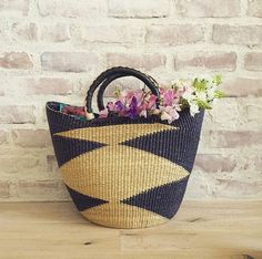 0e3114991ce2 The prettiest woven basket for flowers    via  lauren Lauren Conrad
