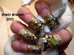 Pinched Duck/Flare tip Cheetah nails . I used cheetah tape inside the nail . CLICK PICTURE to watch video on how to ! Then SUSCRIBE !