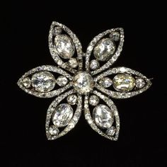 Floral brooch of rose- and brilliant-cut diamonds set in silver, made in Northern Europe, about 1780-1800. Height: 5.9 cm, Width: 6.7 cm, Depth: 1.6 cm