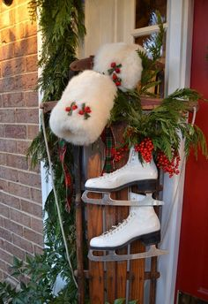 Vintage sled with muffs and ice skates entry decoration